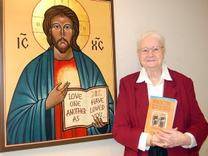 Sister Ann Kessler and the Sacred Heart of Jesus Icon at her monastery's entrance